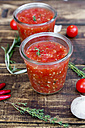Two glasses of homemade tomato sauce and ingredients on wood - SARF03044