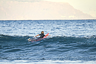 Spain, Tenerife, boy surfing in the sea - SIPF01000