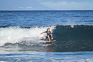 Spain, Tenerife, boy surfing in the sea - SIPF01003