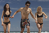 Happy friends running on the beach - ZEF11295