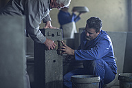 Workers wiping object in industrial pot factory - ZEF11367