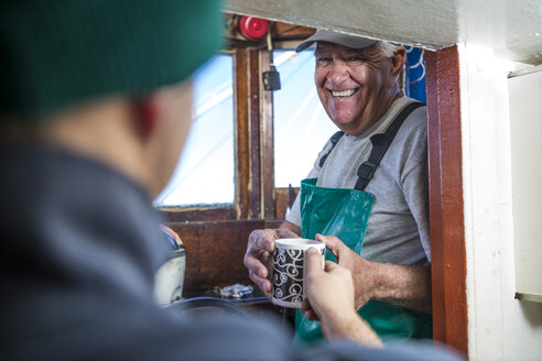 Fisherman getting cup of coffee - ZEF11400
