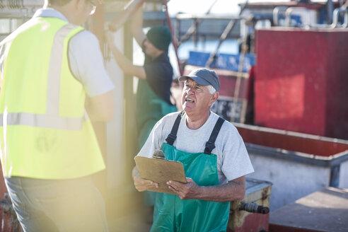 Fisherman on trawler talking to inspector - ZEF11403