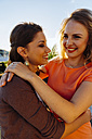 Two happy friends embracing on roof terrace - AIF00420