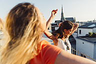 Austria, Vienna, two women dancing on roof terrace - AIF00423