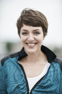 Portrait of happy young woman with short brown hair - TAMF00761