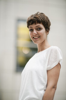 Portrait of smiling young woman with short brown hair - TAMF00767