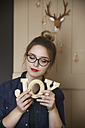 Woman with wooden letters forming the word 'joy' - RTBF00490
