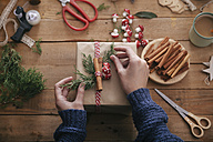 Woman's hands decorating Christmas present - RTBF00499