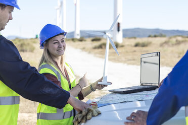 Engineers having a meeting at wind farm - ZEF11520