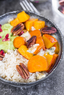 Bowl of autumnal salad with carrots, pumpkin, sweet potatoes, pecan, guacamole, pomegranate and rice - SARF03054