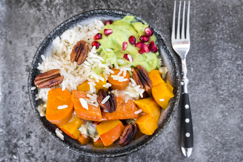 Bowl of autumnal salad with carrots, pumpkin, sweet potatoes, pecan, guacamole, pomegranate and rice - SARF03057