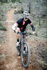 Mountainbiker on forest trail - JRFF00994