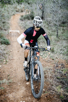 Mountainbiker on forest trail - JRFF00994