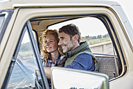 Smiling couple in pick up truck - FMKF03174