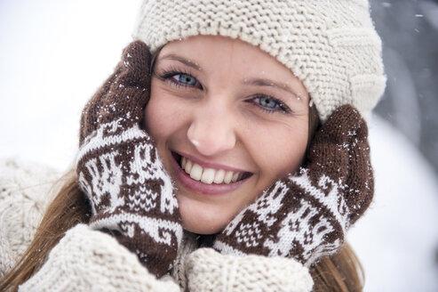 Portrait of smiling woman wearing knitwear in winter - HHF05476