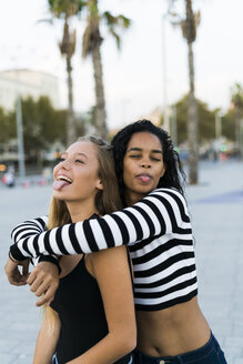 Two playful young women on square - KKAF00024