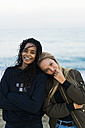 Portrait of two happy young women on the beach - KKAF00030