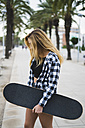Spain, young woman with skateboard - KKAF00041