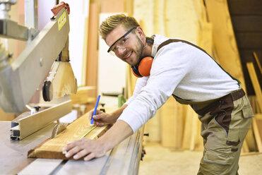 Portrait of confident carpenter in his workshop - LYF00661