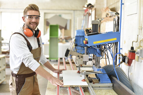 Portrait of confident carpenter in his workshop - LYF00664