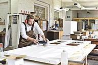 Carpenter restoring a wooden door - LYF00676