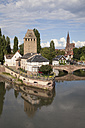 France, Strasbourg, Covered stone bridges and towers in Peteite France at Ill river - WI03375