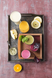 Five glasses of different smoothies and ingredients on tray - MYF01829