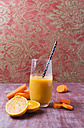 Glass of orange carrot smoothie - MYF01835