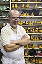 Portrait of a confident shoemaker in his workshop - ABZF01486