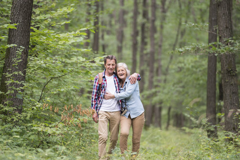 Happy senior couple walking in the woods - HAPF01080