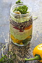Glass of salad with lentils, quinoa, avocado, vegetables and walnuts - ODF01461