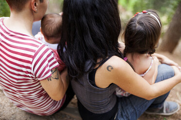 Back view of lesbian couple with two children - VABF00839