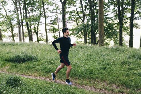 Man running on forest track - BOYF00632