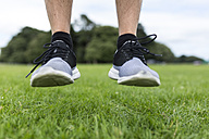 Shoes of athlete jumping on meadow - BOYF00659