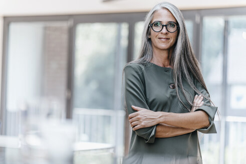 Portrait of smiling woman with long grey hair - KNSF00542