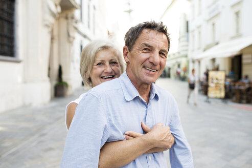 Slovakia, Bratislava, portrait of happy senior couple - HAPF01126