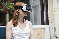 Redheaded woman wearing Virtual Reality Glasses - TAMF00779