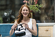 Portrait of laughing redheaded woman with Virtual Reality Glasses - TAMF00782