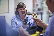 Smiling woman paying with credit card - ZEF11605