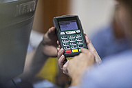 Customer using credit card reader at store - ZEF11608