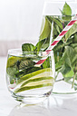 Glass and carafe of detox water with mint and limes - SBDF03065