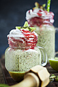 Glass of kiwi limes smoothie with coconut cream and raspberry sauce - SBDF03068