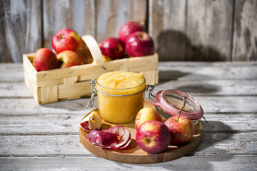 Preserving jar of homemade applesauce and apples - MAEF12048