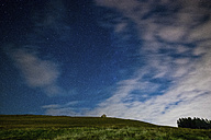 Italy, Bielmonte, starry sky above alpine meadow - SIPF01093