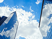 Germany, Frankfurt, office towers with reflection of clouds on facade - KRPF02009