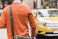 USA, New York City, Businessman approaching cab - UUF09241