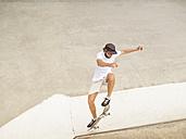 Young man skate boarding in skate park - LAF01806
