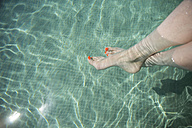 Female feet in swimming pool - CHPF00330