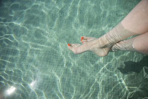 Female feet in swimming pool - CHPF00330